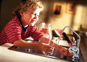 boy_with_glassnewfaucet-300x214